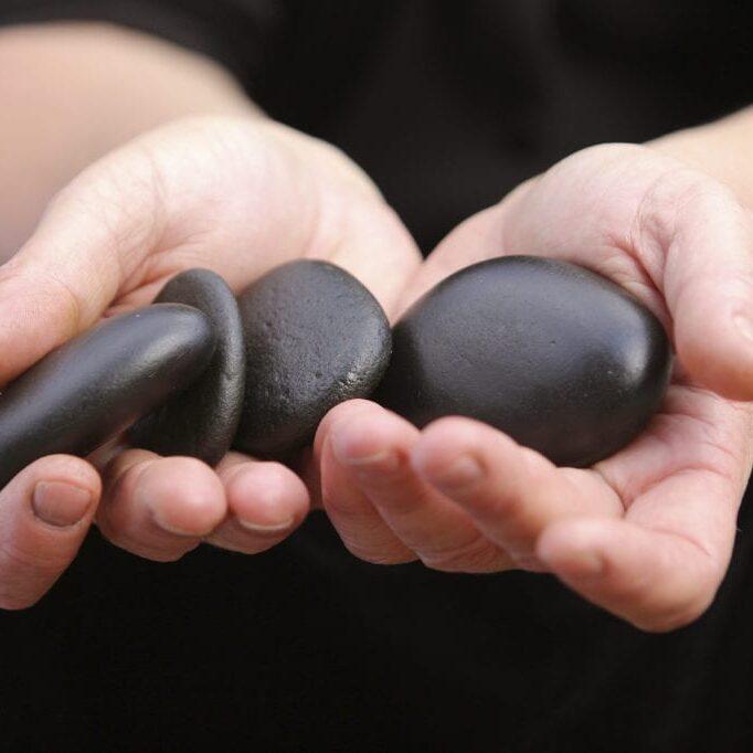 iStock - hot stones in hand